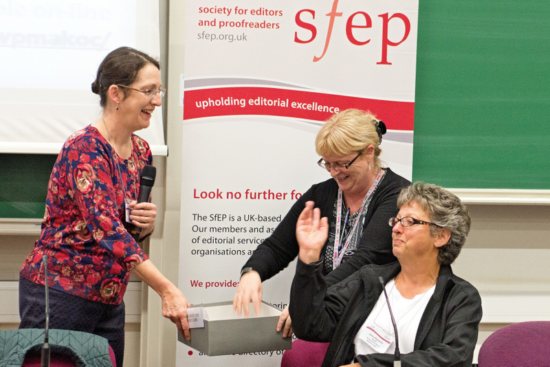 Lucy Metzger (SfEP vice-chair), Helen Martin (SfEP office manager) and Jan Rayment (SI chair) draw the raffle